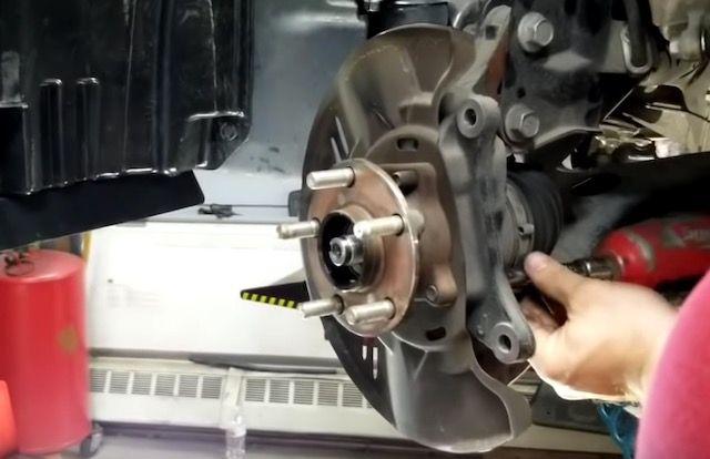 Subaru wheel hub being installed