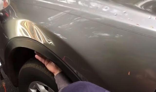 damaged mazda fender